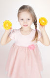 Funny little girl with oranges Royalty Free Stock Photo