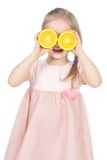 Funny little girl with oranges over white Stock Image