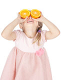 Funny little girl with oranges over white Royalty Free Stock Photography