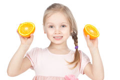 Funny little girl with oranges over white Royalty Free Stock Image