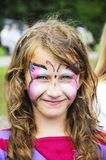 Funny little girl with painted face royalty free stock photo