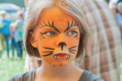 Funny little girl with painted face royalty free stock image