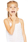 Funny little girl with pigtails. Funny little girl with a charming smile in a white dress Stock Photography