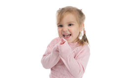 Funny little girl in a pink jersey. Mischievous little girl in a pink jersey Royalty Free Stock Images