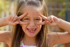 Funny little girl on the playground Stock Image