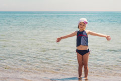 Funny little girl playing on the beach. Selective focus Stock Images