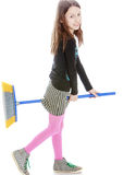Funny little girl playing with a brush Stock Photography