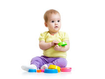 Funny little girl playing with cup toys royalty free stock images