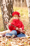 Funny little girl playing guitar Stock Photos