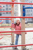 Funny little girl playing on playground Stock Images