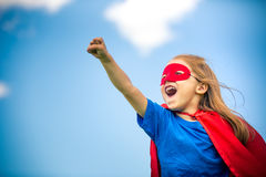 Funny little girl playing power super hero. Royalty Free Stock Photos