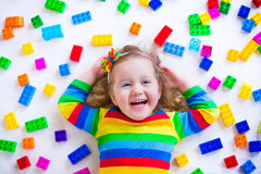 Funny little girl playing with toy blocks Royalty Free Stock Photos