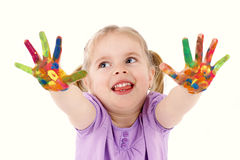 Funny little girl playing with watercolors Stock Images