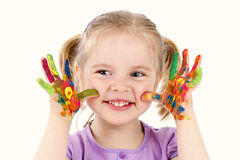 Funny little girl playing with watercolors Stock Photo