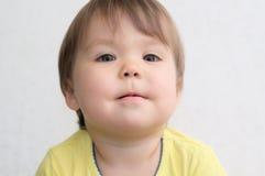 Funny little girl portrait wondering Stock Image