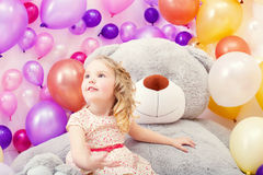Funny little girl posing with big teddy bear Stock Photography