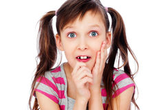 Funny little girl pull faces royalty free stock images