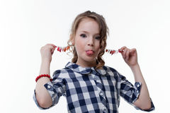 Funny little girl pulls herself for earrings Royalty Free Stock Photo