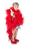 Funny little girl in a red boa Royalty Free Stock Image