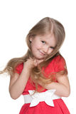 Funny little girl in the red dress Stock Image