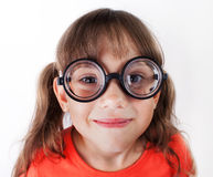 Funny little girl in round glasses Royalty Free Stock Images