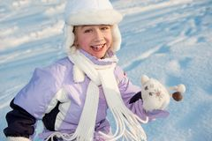 Funny little girl running in the snow Royalty Free Stock Images