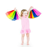 Funny little girl after sale with her colorful bags Royalty Free Stock Photography