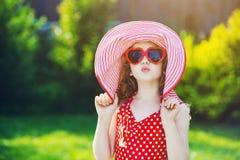 Funny little girl sends an air kiss. Stock Photos