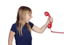 Funny little girl shoutin whit a red phone Royalty Free Stock Photo