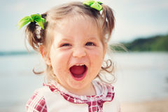 Funny little girl shouting at the sea Royalty Free Stock Image