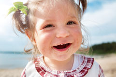 Funny little girl shouting at the sea Royalty Free Stock Images