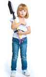 Funny little girl with a shovel in his hands Stock Image