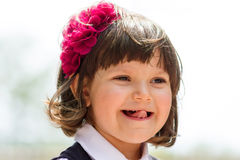 Funny little girl showing her tongue Stock Images