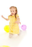 Funny little girl sitting on the floor Royalty Free Stock Photos