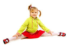 Funny little girl sitting on twine Royalty Free Stock Photo