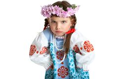 Funny little girl in slavic costume and wreath Stock Photo