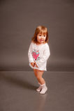 Funny little girl in sleeping suit Stock Photo