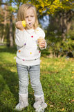 Funny little girl with soap bubbles Stock Photos