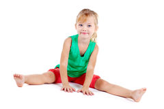Funny little girl in sport's wear Royalty Free Stock Photo