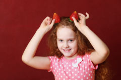 Funny little girl with strawberry ears Stock Photos