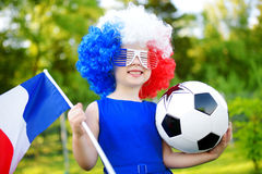 Funny little girl supporting and cheering her national football team Royalty Free Stock Images