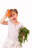 Funny little girl with sweet pepper and dill Royalty Free Stock Photos