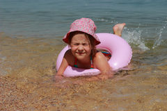 Funny little girl swimming Stock Photography
