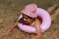 Funny little girl swimming Stock Photos