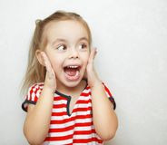Funny little girl taken aback by great surprise royalty free stock photography