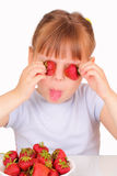 Funny little girl with tasty strawberries Royalty Free Stock Photos