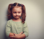 Funny little girl with thinking face looking with empty space Royalty Free Stock Photos
