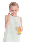Funny little girl with the thumb up Royalty Free Stock Photo