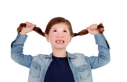 Funny little girl toothless pulling her pigtails Royalty Free Stock Image