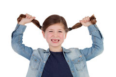 Funny little girl toothless pulling her pigtails Stock Images